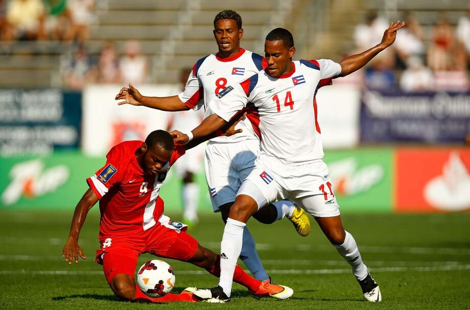 HARTFORD, CT - JULY 16: Alianni Urgelles #14 of Cuba fouls Deon McCaulay #9 of Belize during the CONCACAF Gold Cup match at Rentschler Field on July 16, 2013 in East Hartford, Connecticut. (Photo by Jared Wickerham/Getty Images) ***Local Caption*** Alianni Urgelles; Deon McCaulay