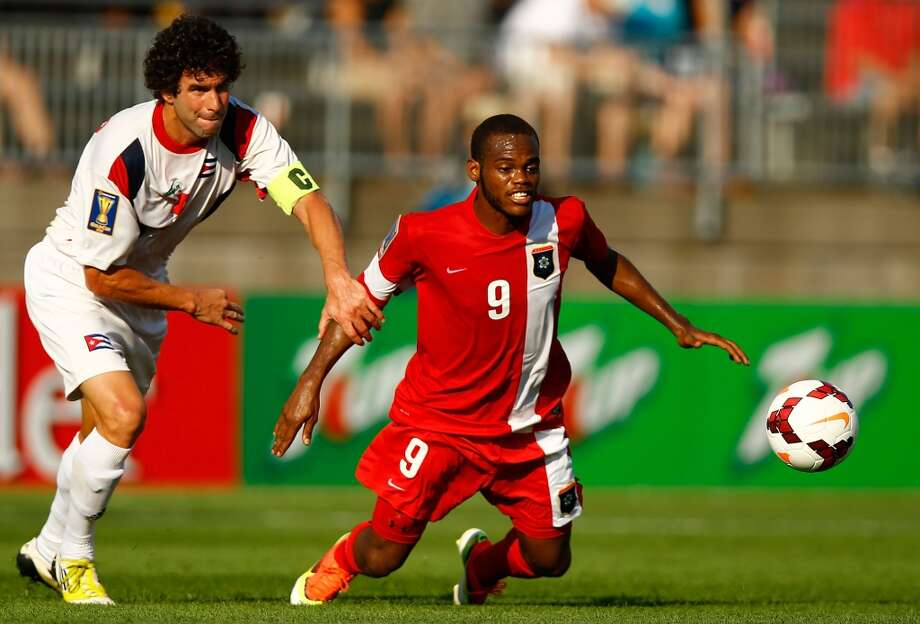 HARTFORD, CT - JULY 16: Jorge Luis Clavelo #5 of Cuba fouls Deon McCaulay during the CONCACAF Gold Cup match at Rentschler Field on July 16, 2013 in East Hartford, Connecticut. (Photo by Jared Wickerham/Getty Images) ***Local Caption*** Jorge Luis Clavelo; Deon McCaulay