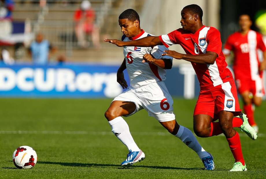 HARTFORD, CT - JULY 16: Yoel Colome #6 of Cuba fights for the ball against Evan Mariano #6 of Belize during the CONCACAF Gold Cup match at Rentschler Field on July 16, 2013 in East Hartford, Connecticut. (Photo by Jared Wickerham/Getty Images) ***Local Caption*** Yoel Colome; Evan Mariano