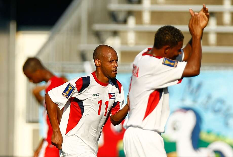HARTFORD, CT - JULY 16: Ariel Pedro Martinez #11 of Beliz celebrates with teammates on the bench after scoring a goal in the first half against Cuba during the CONCACAF Gold Cup match at Rentschler Field on July 16, 2013 in East Hartford, Connecticut. (Photo by Jared Wickerham/Getty Images) ***Local Caption*** Ariel Pedro Martinez