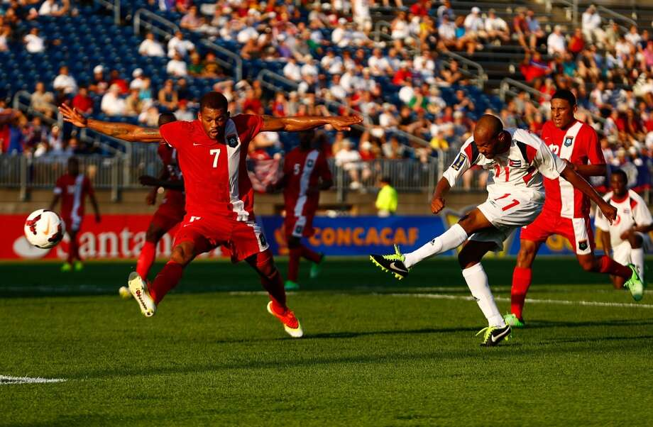 HARTFORD, CT - JULY 16: Ariel Pedro Martinez #11 shoots and scores his second goal against Belize in the second half during the CONCACAF Gold Cup match at Rentschler Field on July 16, 2013 in East Hartford, Connecticut. (Photo by Jared Wickerham/Getty Images)