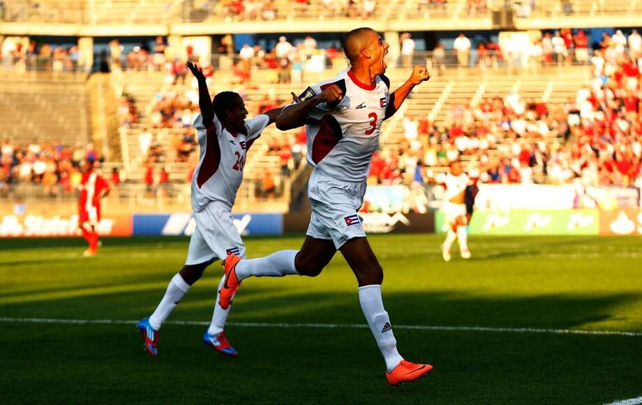 HARTFORD, CT - JULY 16: Jeniel Molina #3 of Cuba celebrates after scoring a goal in the 90th minute against Belize during the CONCACAF Gold Cup match at Rentschler Field on July 16, 2013 in East Hartford, Connecticut. (Photo by Jared Wickerham/Getty Images)