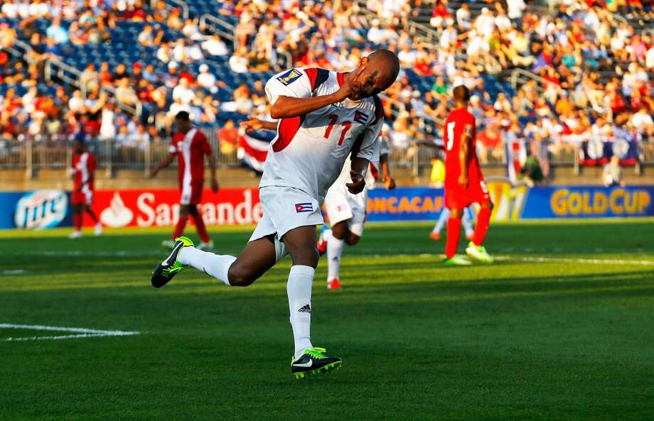 HARTFORD, CT - JULY 16: Ariel Pedro Martinez #11 of Cuba celebrates after scoring his third goal against Belize in the second half during the CONCACAF Gold Cup match at Rentschler Field on July 16, 2013 in East Hartford, Connecticut. (Photo by Jared Wickerham/Getty Images)