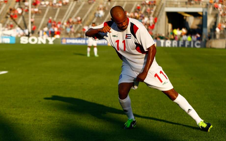 HARTFORD, CT - JULY 16: Ariel Pedro Martinez #11 of Cuba celebrates after scoring his second goal against Belize in the second half during the CONCACAF Gold Cup match at Rentschler Field on July 16, 2013 in East Hartford, Connecticut. (Photo by Jared Wickerham/Getty Images)