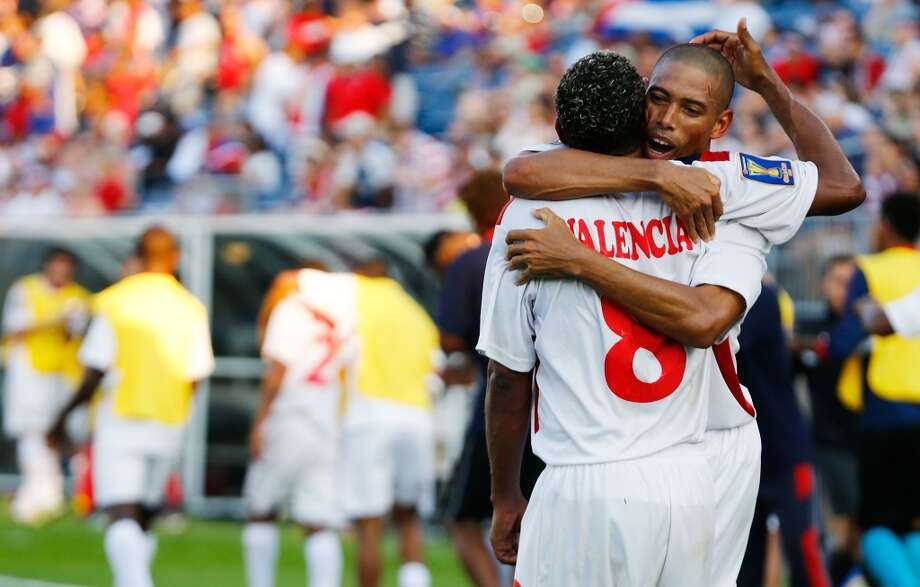 HARTFORD, CT - JULY 16: Jeniel Molina #3 of Cuba is celebrates with teammate Jaine Valencia #8 of Cuba after scoring a goal in the 90th minute against Belize during the CONCACAF Gold Cup match at Rentschler Field on July 16, 2013 in East Hartford, Connecticut. (Photo by Jared Wickerham/Getty Images)