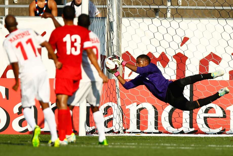 HARTFORD, CT - JULY 16: Woodrow West #1 of Belize makes a save in the first half against Cuba during the CONCACAF Gold Cup match at Rentschler Field on July 16, 2013 in East Hartford, Connecticut. (Photo by Jared Wickerham/Getty Images)