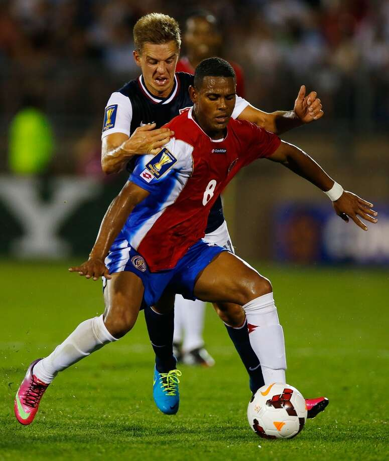 HARTFORD, CT - JULY 16: Stuart Holden #11 of the United States fights for the ball against Kenny Cunningham #8 of Costa Rica during the CONCACAF Gold Cup match at Rentschler Field on July 16, 2013 in East Hartford, Connecticut. (Photo by Jared Wickerham/Getty Images)