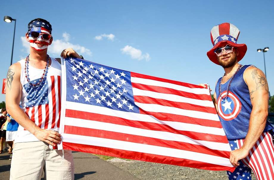 HARTFORD, CT - JULY 16: USA fans pose for a portrait outside of the stadium with the American flag prior to the USA vs Costa Rica CONCACAF Gold Cup match at Rentschler Field on July 16, 2013 in East Hartford, Connecticut. (Photo by Jared Wickerham/Getty Images)