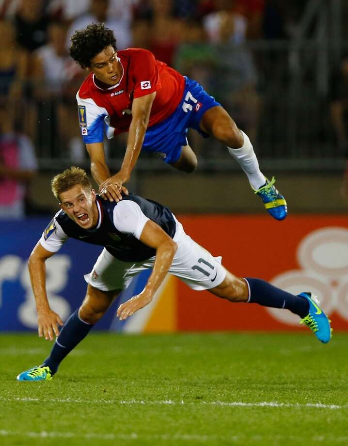 HARTFORD, CT - JULY 16: Yeltsin Tejeda #17 of Costa Rica goes up for a header against Stuart Holden #11 of the United States in the first half during the CONCACAF Gold Cup match at Rentschler Field on July 16, 2013 in East Hartford, Connecticut. (Photo by Jared Wickerham/Getty Images)