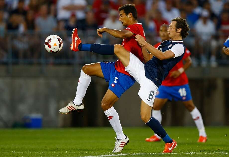 HARTFORD, CT - JULY 16: Celso Borges #5 of Costa Rica fights for the ball against Mix Diskerud #8 of the United States in the first half during the CONCACAF Gold Cup match at Rentschler Field on July 16, 2013 in East Hartford, Connecticut. (Photo by Jared Wickerham/Getty Images)