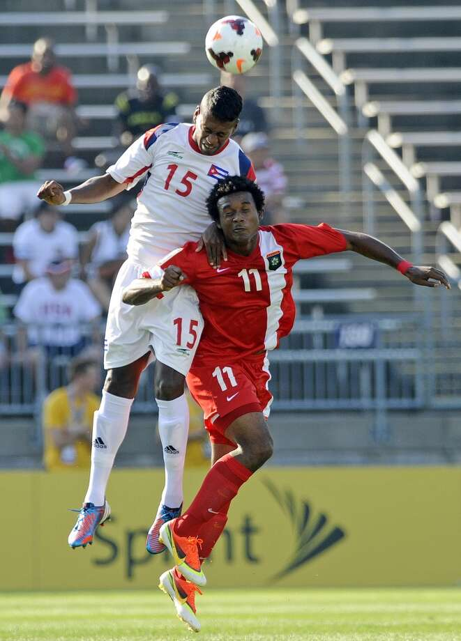 Cuba's Renay Malblanche, left, and Belize's Michael Salazar fight for a ball during the first half of a CONCACAF Gold Cup soccer match Tuesday, July 16, 2013, in East Hartford, Conn. (AP Photo/Fred Beckham)