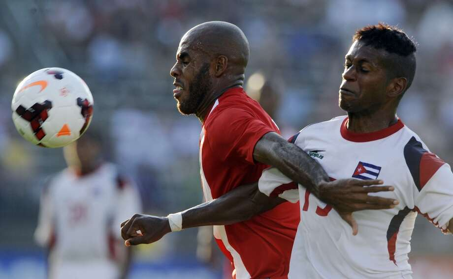 Cuba's Renay Malblanche, right, and Belize's Trevor Lennen fight for a ball during the second half of a CONCACAF Gold Cup soccer match Tuesday, July 16, 2013, in East Hartford, Conn. Cuba won 4-0. (AP Photo/Fred Beckham)