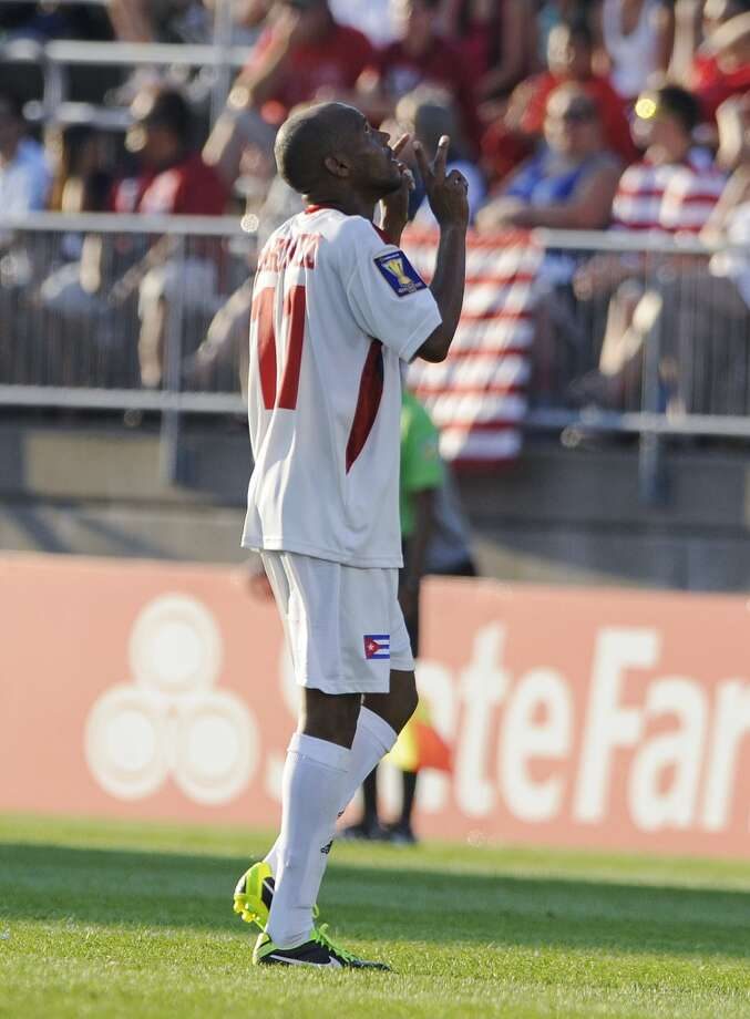 Cuba's Ariel Pedro Martizez, left, celebrates after scoring his second goal goal, during the second half of a CONCACAF Gold Cup soccer match against Belize on Tuesday, July 16, 2013, in East Hartford, Conn. Cuba won 4-0. (AP Photo/Fred Beckham)