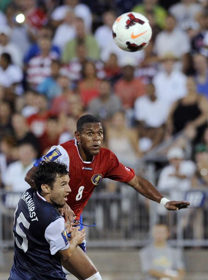 United States' Michael Parkhurst, left, and Costa Rica's Kenny Cunningham watch the ball during the first half of a CONCACAF Gold Cup soccer match Tuesday, July 16, 2013, in East Hartford, Conn. (AP Photo/Fred Beckham)