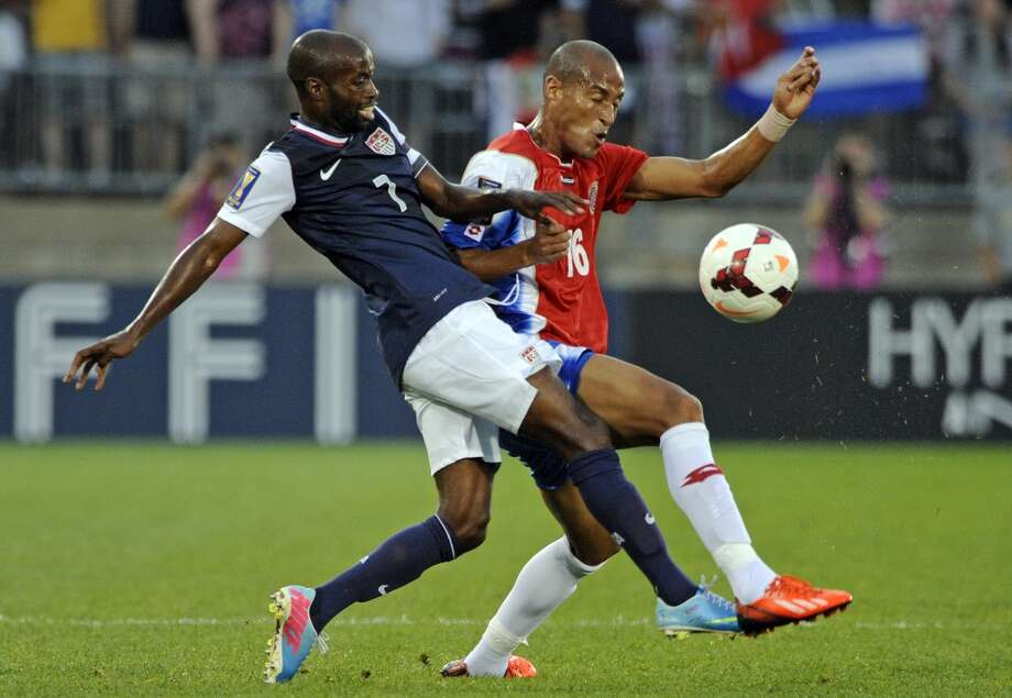 United States' DaMarcus Beasley, left, and Costa Rica's Carlos Johnson fight for a loose ball during the first half of a CONCACAF Gold Cup soccer match Tuesday, July 16, 2013, in East Hartford, Conn. (AP Photo/Fred Beckham)