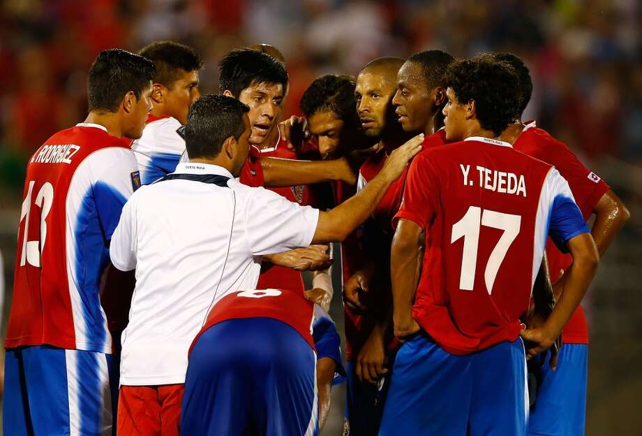 HARTFORD, CT - JULY 16: Members of the Costa Rica national team huddle together following their 1-0 loss to the United States during the CONCACAF Gold Cup match at Rentschler Field on July 16, 2013 in East Hartford, Connecticut. (Photo by Jared Wickerham/Getty Images)