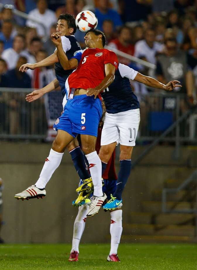 HARTFORD, CT - JULY 16: Celso Borges #5 of Costa Rica goes up for a header against the United States in the second half during the CONCACAF Gold Cup match at Rentschler Field on July 16, 2013 in East Hartford, Connecticut. (Photo by Jared Wickerham/Getty Images)