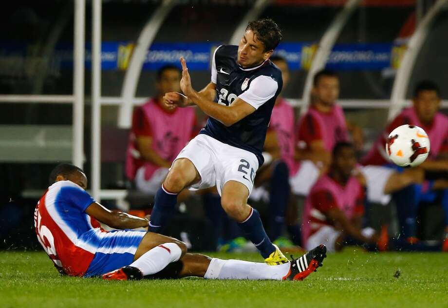 HARTFORD, CT - JULY 16: Alejandro Bedoya #20 of the United States fouls Junior Diaz #15 of Costa Rica in the second half during the CONCACAF Gold Cup match at Rentschler Field on July 16, 2013 in East Hartford, Connecticut. (Photo by Jared Wickerham/Getty Images)