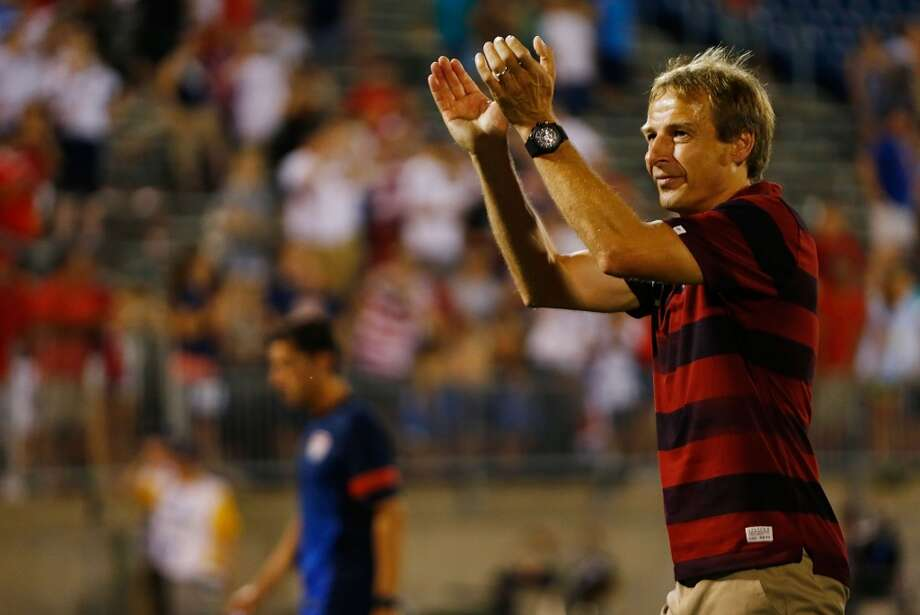 HARTFORD, CT - JULY 16: Head coach Jurgen Klinsmann of the United States thanks the fans following their 1-0 win against Costa Rica during the CONCACAF Gold Cup match at Rentschler Field on July 16, 2013 in East Hartford, Connecticut. (Photo by Jared Wickerham/Getty Images)