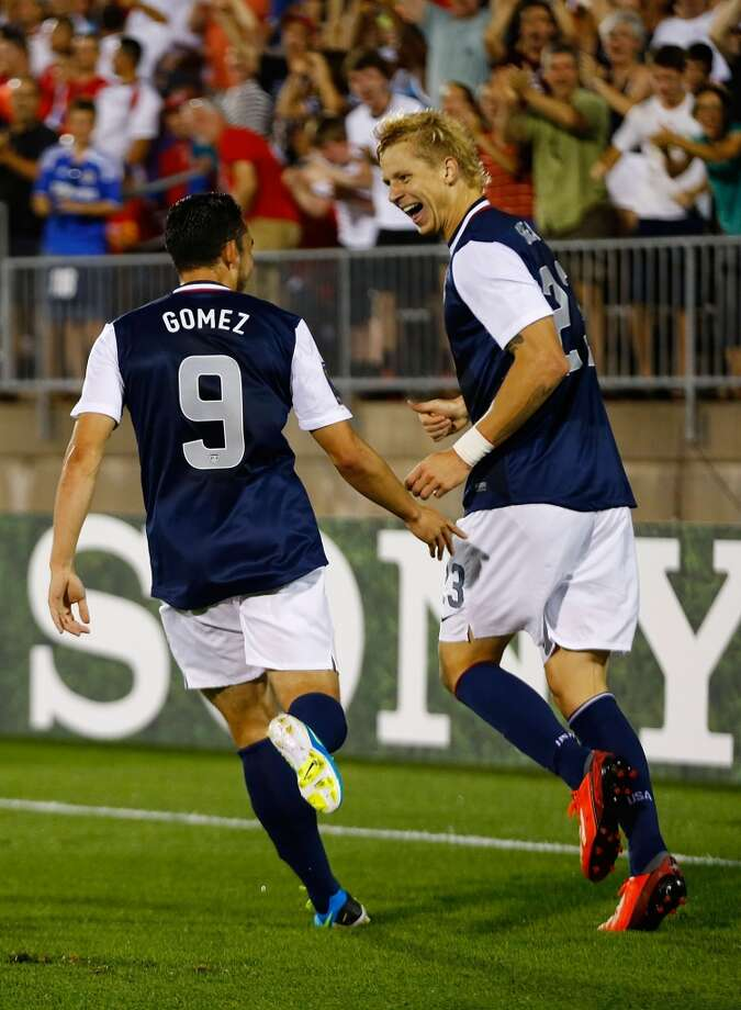 HARTFORD, CT - JULY 16: Brek Shea #23 of the United States celebrates his goal with teammate Herculez Gomez #9 after scoring late in the second half against Costa Rica during the CONCACAF Gold Cup match at Rentschler Field on July 16, 2013 in East Hartford, Connecticut. (Photo by Jared Wickerham/Getty Images)