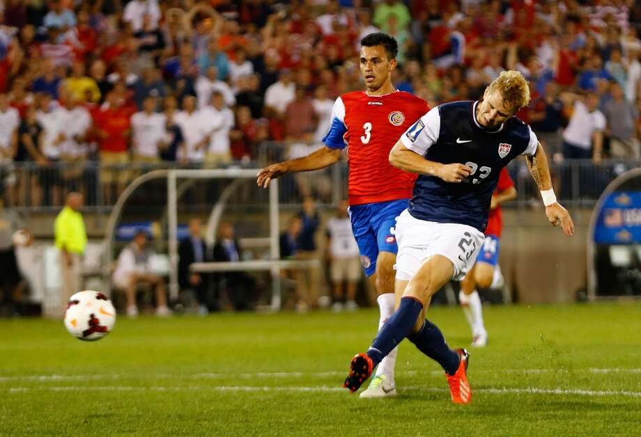 HARTFORD, CT - JULY 16: Brek Shea #23 of the United States shoots and scores a goal late in the second half in front of Kendall Watson #3 of Costa Rica during the CONCACAF Gold Cup match at Rentschler Field on July 16, 2013 in East Hartford, Connecticut. (Photo by Jared Wickerham/Getty Images)