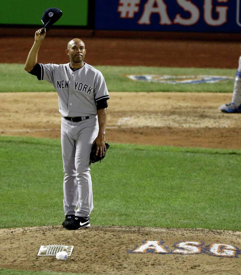 American League's Mariano Rivera, of the New York Yankees, acknowledges the crowd as he is introduced during the eighth inning of the MLB All-Star baseball game, on Tuesday, July 16, 2013, in New York. (AP Photo/Frank Franklin II) Photo: Frank Franklin II, Associated Press / AP