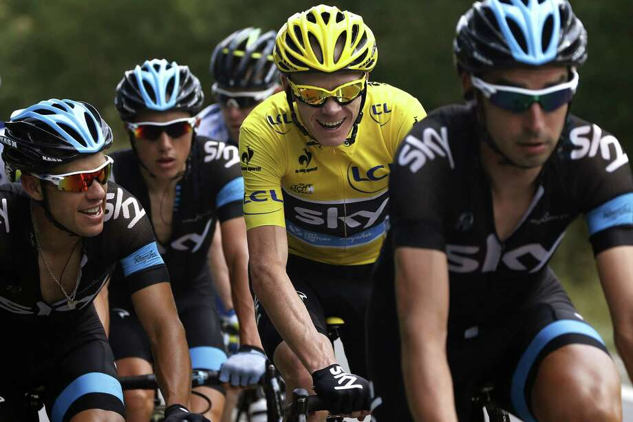 Overall leader's yellow jersey Britain's Christopher Froome (2ndR) rides behind his teammates in the pack during the 168 km sixteenth stage of the 100th edition of the Tour de France cycling race on July 16, 2013 between Vaison-la-Romaine and Gap, southeastern France.   TOPSHOTS/AFP PHOTO/PASCAL GUYOTPASCAL GUYOT/AFP/Getty Images ORG XMIT: 169056469 Photo: PASCAL GUYOT / AFP