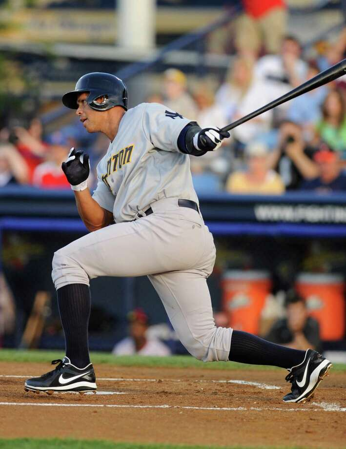 New York Yankees' Alex Rodriguez grounds out in the first inning of a Class AA baseball game with the Trenton Thunder against the Reading Phillies, Monday, July 15, 2013, in Reading, Pa. Rodriguez is doing a rehab assignment with the Thunder recuperating from hip surgery. (AP Photo/Bradley C Bower) ORG XMIT: PABB109 Photo: Bradley C. Bower / FR37962 AP