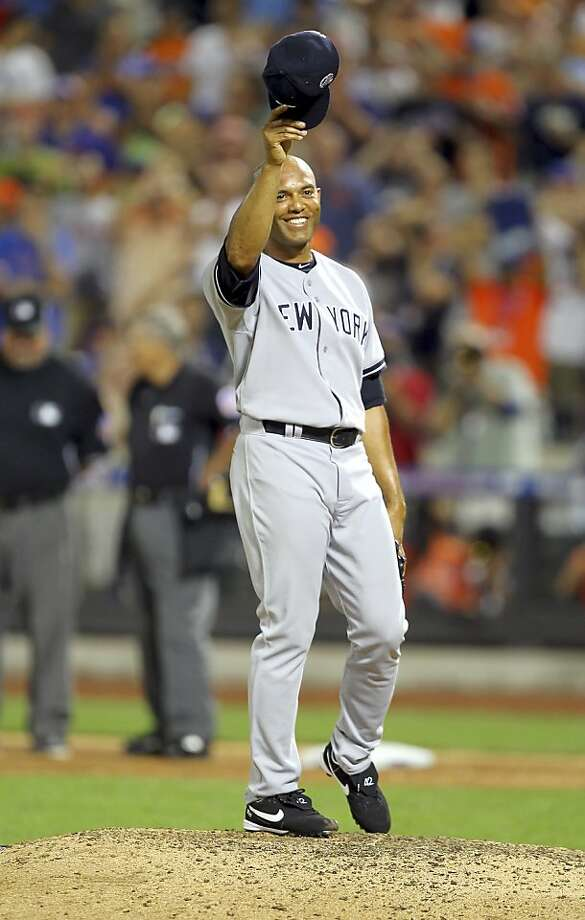 Yankees closer Mariano Rivera tips his cap as he makes his solo entrance in the eighth inning. The all-time saves leader retired the side in order and was named the game's MVP. Photo: Suzy Allman, New York Times