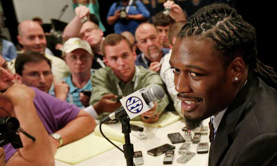 As one of the nation's best defensive players and a possible No. 1 overall pick in the NFL draft, South Carolina's Jadeveon Clowney was a popular figure at SEC Media Days last week. Photo: Dave Martin, STF / AP