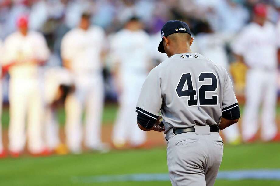 NEW YORK, NY - JULY 16:  American League All-Star Mariano Rivera #42 of the New York Yankees takes the field priot to the 84th MLB All-Star Game on July 16, 2013 at Citi Field in the Flushing neighborhood of the Queens borough of New York City.  (Photo by Mike Ehrmann/Getty Images) ORG XMIT: 173341585 Photo: Mike Ehrmann / 2013 Getty Images