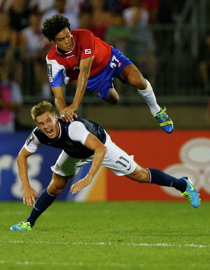 Costa Rica's Yeltsin Tejeda, top, goes up for a header against Stuart Holden. Photo: Jared Wickerham, Staff / 2013 Getty Images