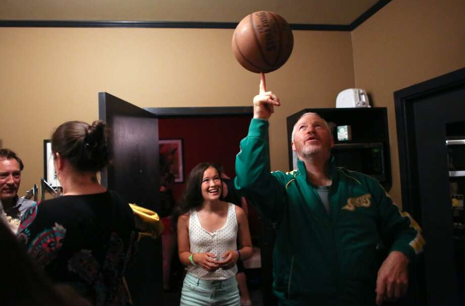 "Seattle Mayor Mike McGinn spins a basketball backstage during ""Candidate Survivor,"" a distinctly Seattle twist on local politics. McGinn showed off his juggling and basketball-handling skills at the unique event. Photo: JOSHUA TRUJILLO, SEATTLEPI.COM"