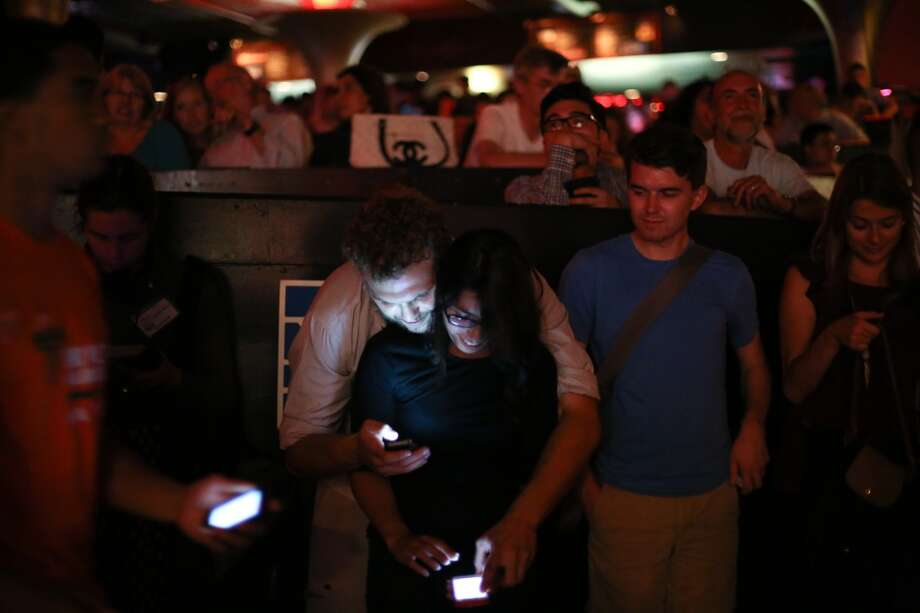 "People text their votes during ""Candidate Survivor."" Photo: JOSHUA TRUJILLO, SEATTLEPI.COM"