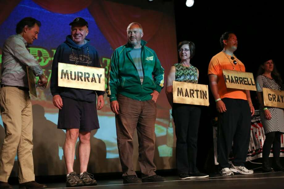 "Candidates, from left, Peter Steinbrueck, Ed Murray, Mike McGinn, Kate Martin, Bruce Harrell and Joey Gray are shown on stage during ""Candidate Survivor,"" a distinctly Seattle twist on local politics. The unique event featured six of the candidates for Seattle mayor answering questions and audience members voting for them via text messages. During one segment, candidates performed a talent show, getting raucous cheers from hundreds in the audience. The event was held on Tuesday, July 16, 2013 at the Showbox at the Market. Photo: JOSHUA TRUJILLO, SEATTLEPI.COM"