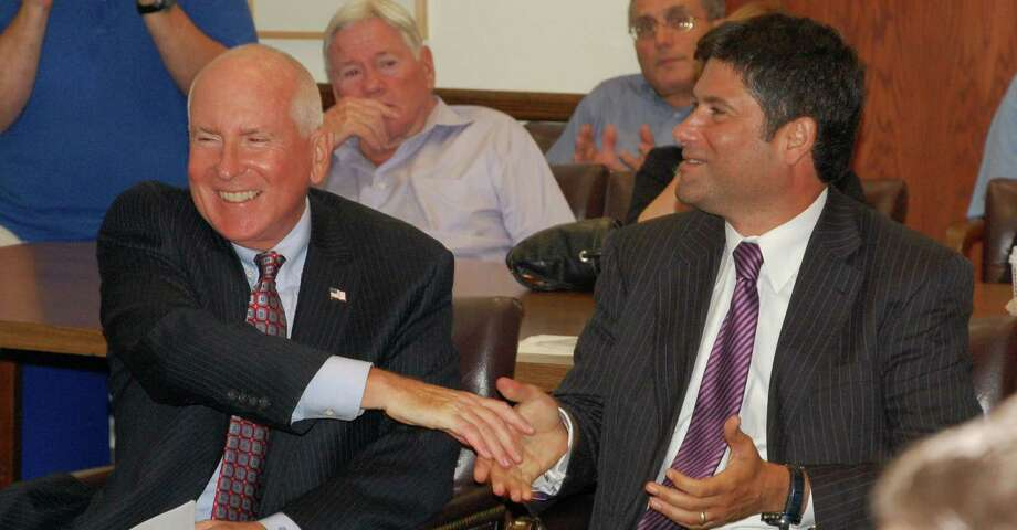 Jim Marpe, left and Avi Kaner share congratulations Tuesday night as the Republican Town Committee unanimously endorsed them to run for first selectman and selectman, respectively, this November. WESTPORT NEWS, CT 7/16/13 Photo: Jarret Liotta / Westport News contributed