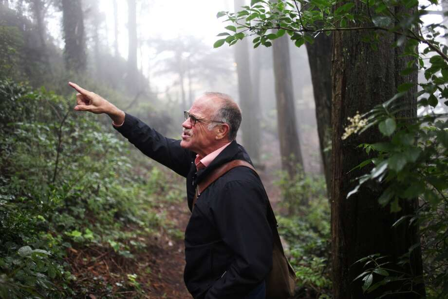 Tim Colen, an Edgehill resident and former geologist, points to geologic formations and discusses the landslide that occurred on the hill in 1997 on July 11, 2013 in the Edgehill Mountain Open Space in San Francisco, Calif.