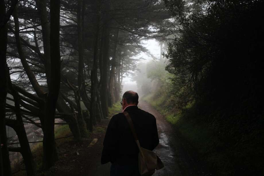 Tim Colen, a former geologist and resident of Edgehill, walks along Edgehill Way on July 11, 2013 in San Francisco, Calif.