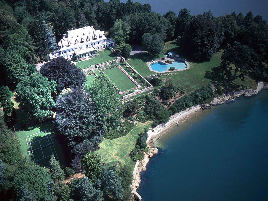 Copper Beech Farm, a 50-acre compound on the waterfront of Greenwich, Conn., has been posted on the market by David Ogilvy & Associates for $190 million, believed the be the highest listing in the United States. The property boasts a carriage house with a clock tower, co-joined heptagonal pools, a greenhouse, wine cellar and grass tennis court. Photo: David Ogilvy & Associates