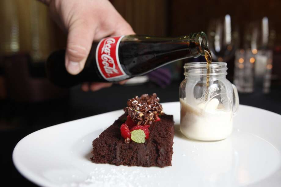 Black Magic cake with ganache and raspberry and a mini-Coke float at Mr. Peeples restaurant.  (Eric Kayne/For the Chronicle) Photo: Eric Kayne