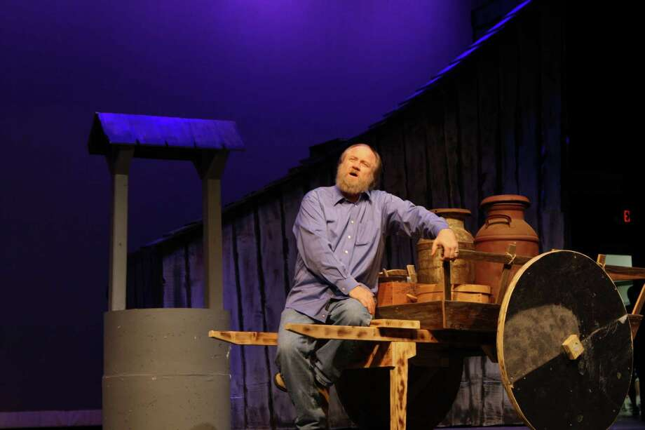 "Tom Neal sits solo during the rehearsal of ""Fiddler on the Roof"" on Thursday night. This is Neal's second time playing the husband in the play; the last time was in 1996. Photo: Jose D. Enriquez III"