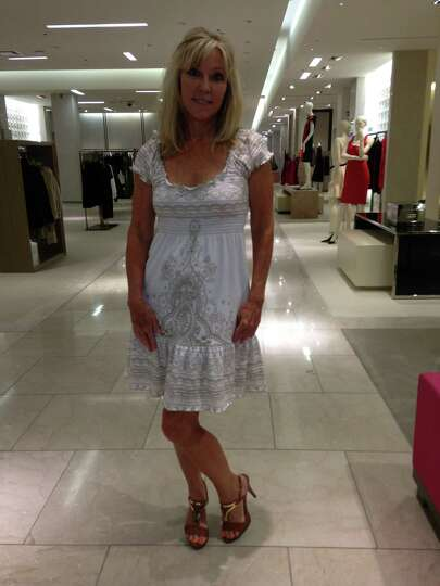 Mo O'Grady proves that wearing a little white dress, this one beautifully-embroidered in ligh