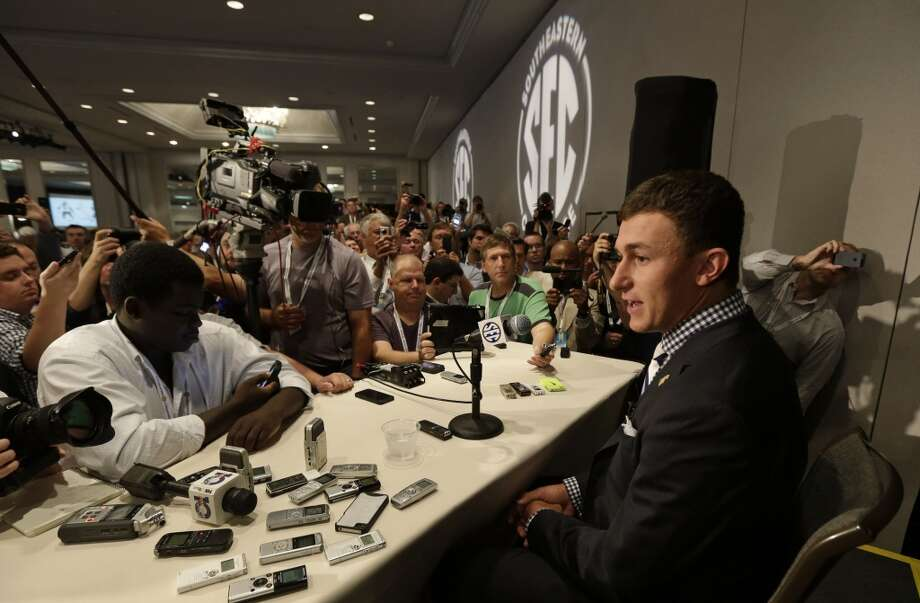 Johnny Manziel looks out to a sea of reporters.