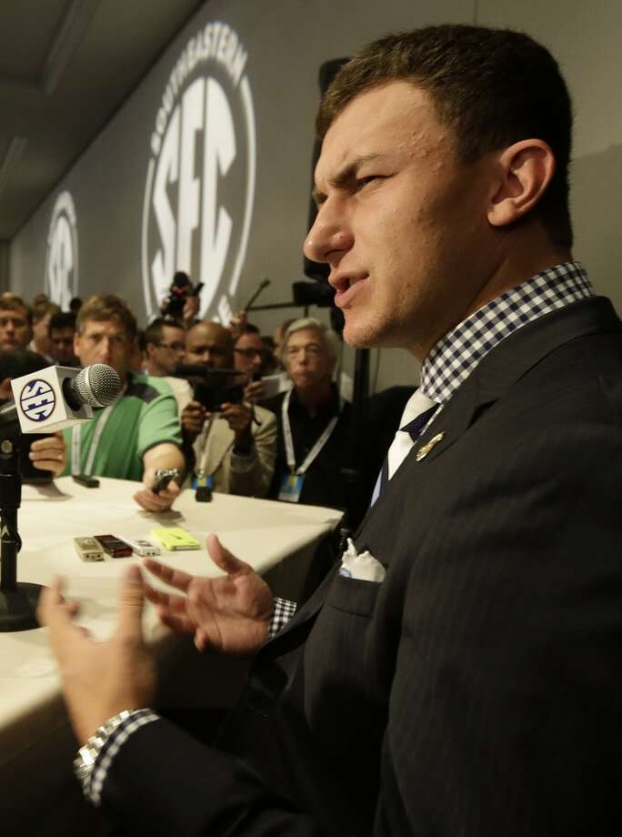 Johnny Manziel talks with reporters.
