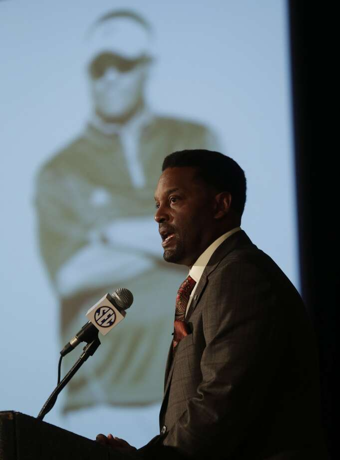Kevin Sumlin at the podium.