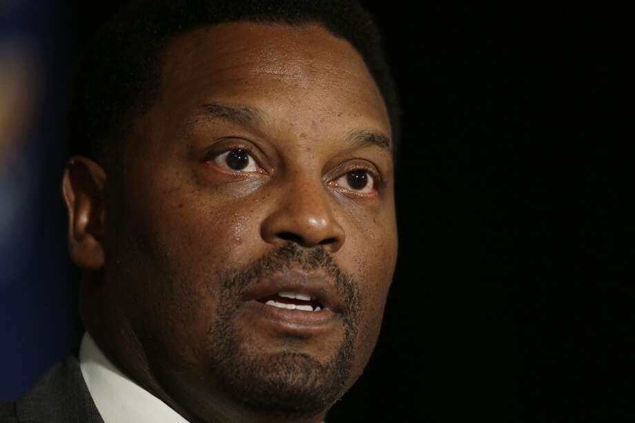 Kevin Sumlin talks with reporters.