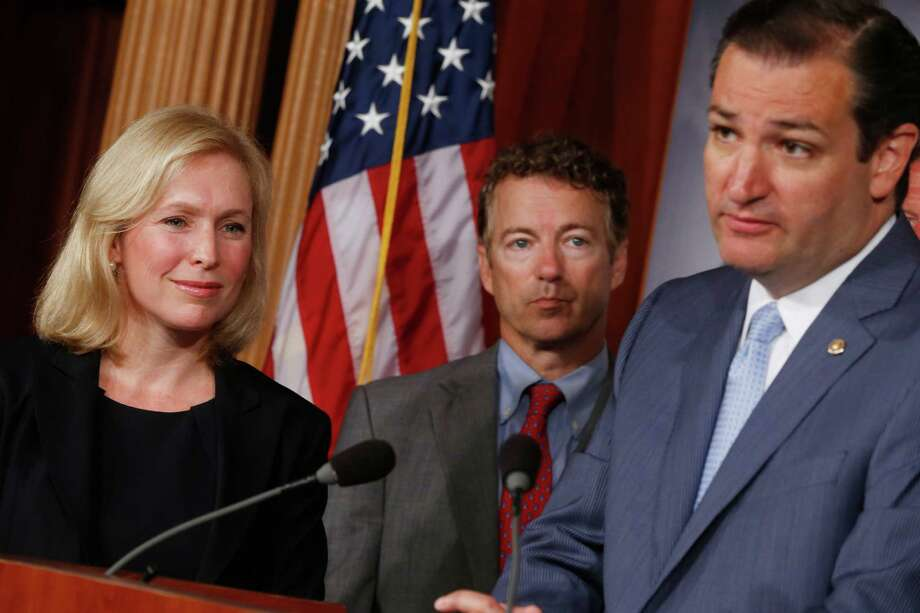 Sen. Kirsten Gillibrand, D-N.Y.,  listens to Sen. Ted Cruz, R-Texas, speak to reporters during a news conference about a bill on military sexual assault cases. We often disagree with Cruz, but we agree with him on this issue. Photo: Charles Dharapak, Associated Press / AP