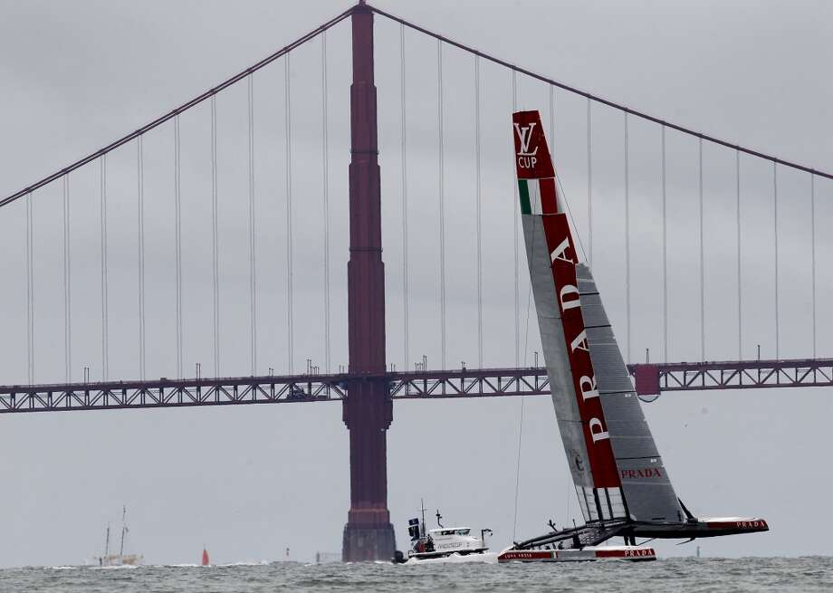 The Luna Rossa AC72 sailed windward towards the Golden Gate Bridge Tuesday July 16, 2013. The Louis Vuitton Cup event on San Francisco bay featured the Italian Luna Rossa AC72 racing the course by itself as the Artemis team is still working on their catamaran.