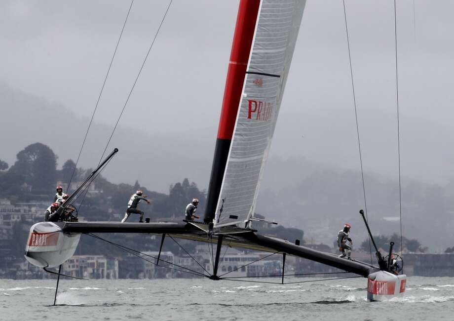 Luna Rossa crew members scampered across the hull during the race Monday July 16, 2013. The Louis Vuitton Cup event on San Francisco bay featured the Italian Luna Rossa AC72 racing the course by itself as the Artemis team is still working on their catamaran.