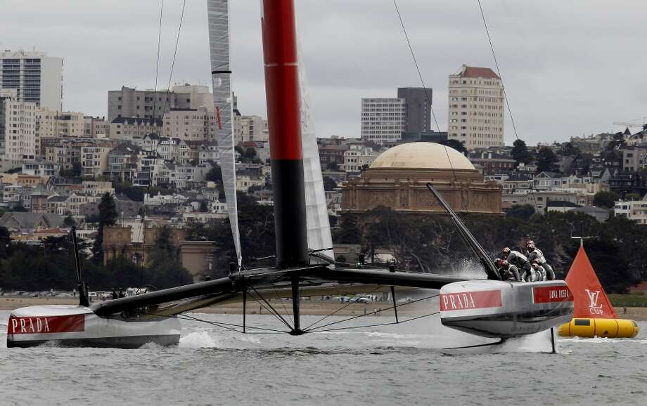The Italian AC72 headed south with the Palace of Fine Arts in the background Tuesday July 16, 2013. The Louis Vuitton Cup event on San Francisco bay featured the Italian Luna Rossa AC72 racing the course by itself as the Artemis team is still working on their catamaran.